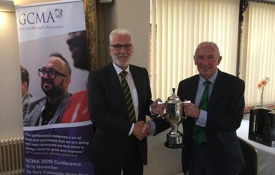 Captain Tony Mears receives Presidents cup from Newport Golf Club Chairman Byron Blakemore.